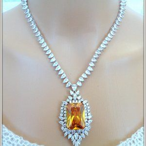 18 K WHITE OVER GLOMURES YELLOW CITRINE NECKLACE